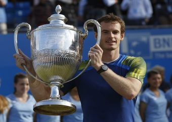 Britain's Murray holds the trophy after beating Croatia's Cilic to win the men's singles final tennis match at the Queen's Club Championships in west London